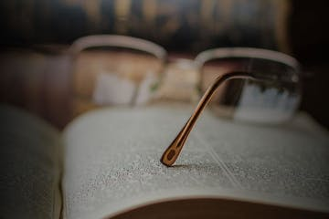 close up of reading glasses on a book
