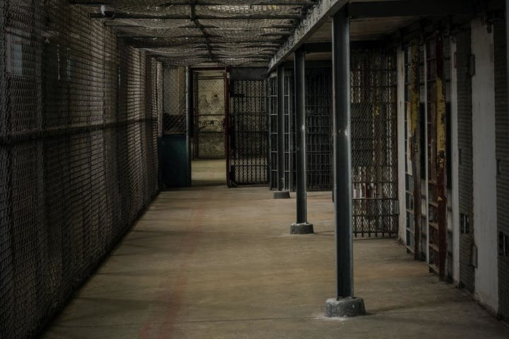 hallway lined with jail cells
