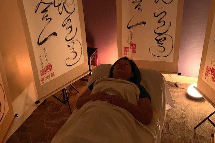 woman laying in harmony room
