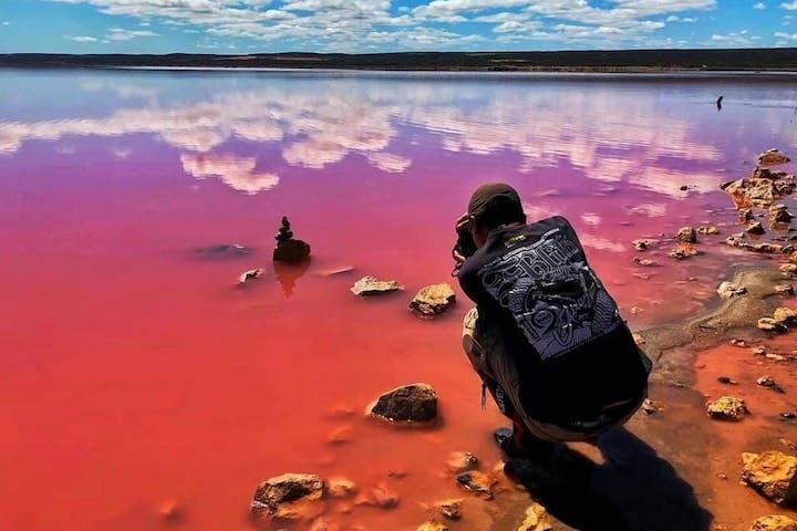 Guy taking a photo on Pink Lake