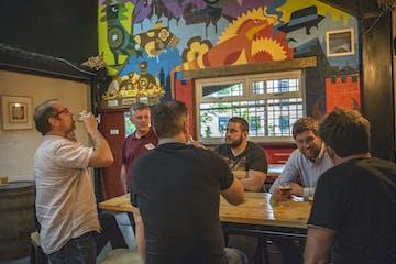 Men having beers in brewery in yorkshire
