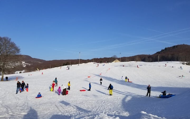 a group of people skiing on the snow