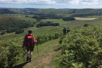 a man walking up a hill