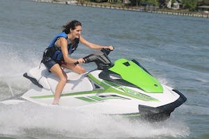 woman riding a waverunner through the water