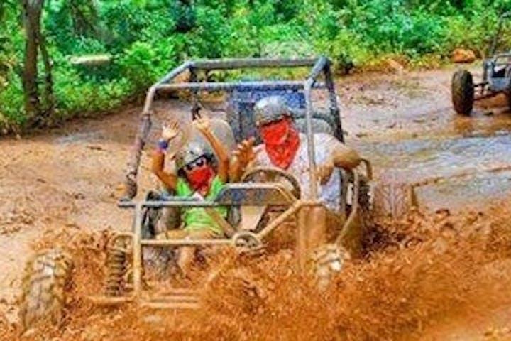 man and child on ATV ride