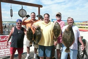 Group posing with fish catch
