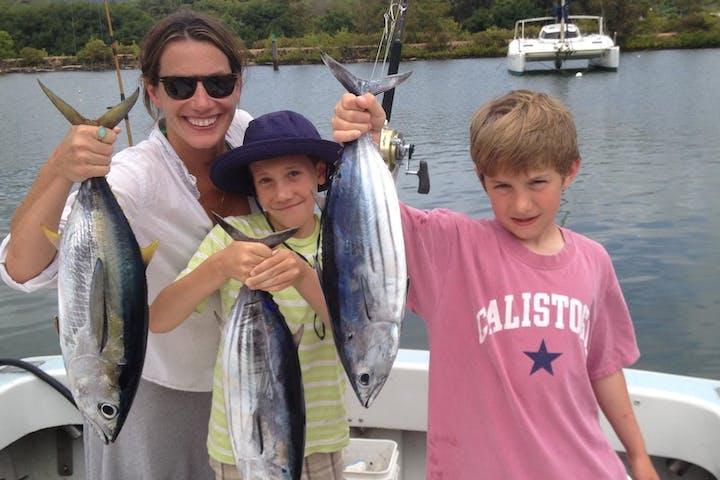 family holding fish