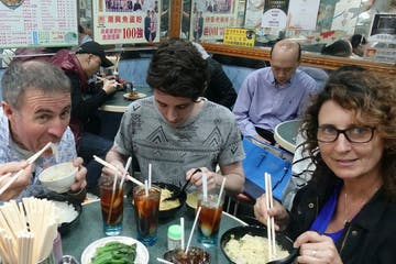 family eating food in hong kong
