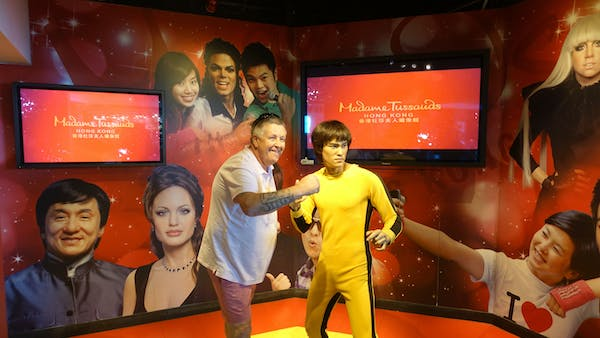 guy having a photo with bruce lee