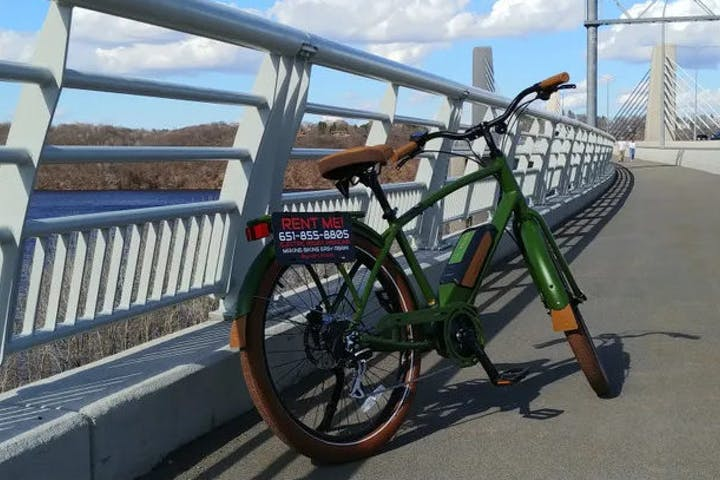 green bike parked on bridge
