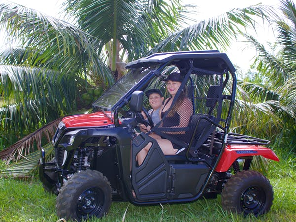 mom and son in ATV