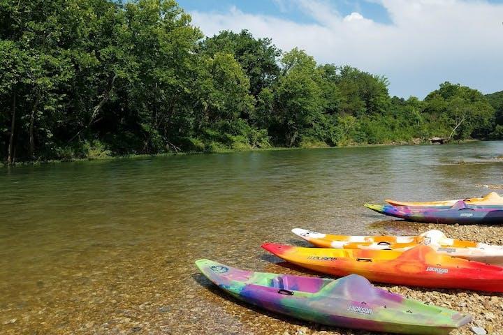 kayaks parked on river bank
