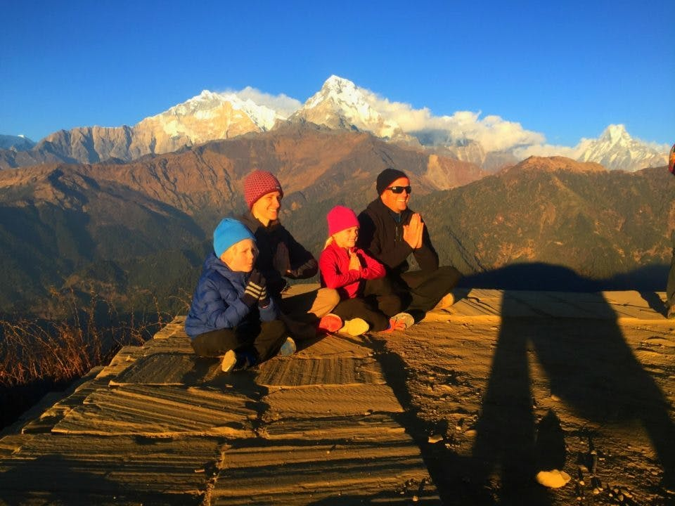 Family meditating in Nepal