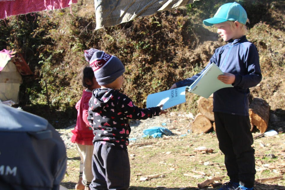 Meeting a local child on a family trek in Nepal.