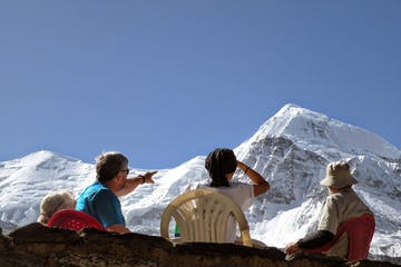 People sitting and watching the mountains