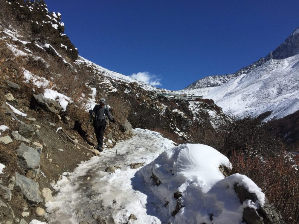 Trekker negotiating an icy trail on the trek to everest base camp