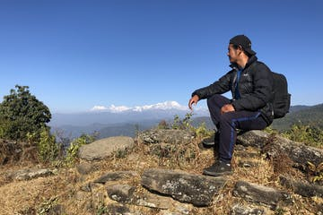Enjoying a Panorama of the Annapurna range.