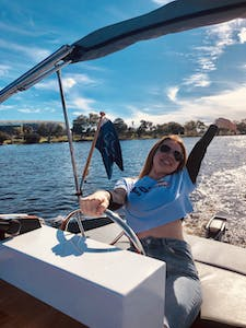 lady thrilled over driving a boat