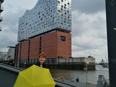 a large building in the rain with an umbrella