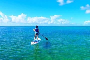 girl paddle boarding