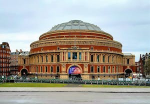 a group of people walking in front of Royal Albert Hall