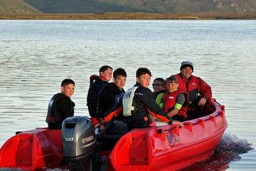 Group of people on board of a red powerboat