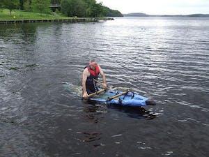 man sailing in a handmade canoe