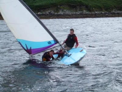 boys sailing on a Topper