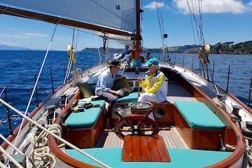 2 people on board on boat sailing to Waiheke Island