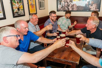 men having a toast with beer