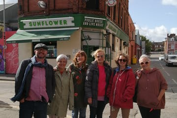group in front of a irish pub