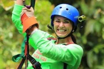 A girl in cloud forest zip line in Monteverde Costa Rica