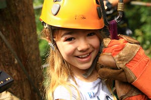 A kid wearing a zipline hat