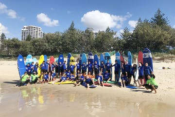 Group of young people doing surf lessons