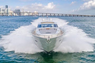yacht on the water before the skyline of miami, fl