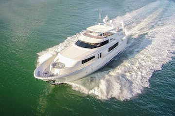 Miami rent a yacht cruising along Biscayne Bay.
