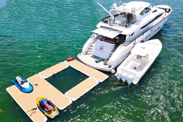 Miami yacht rental at anchor with water toys deployed.