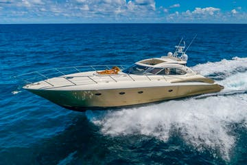 Yacht rental in Miami Beach cruising along the ocean.