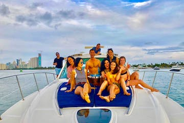 Guest on the bow of this boat for rent in Miami.
