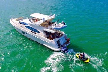 Jetski rider behind this Miami Beach rental yacht.