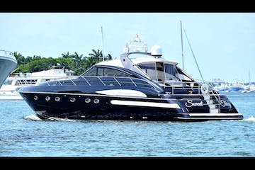 Yacht for rent in Miami Beach approaching its slip.