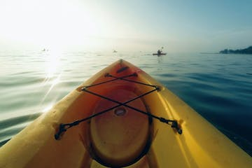 yellow kayak into the sea