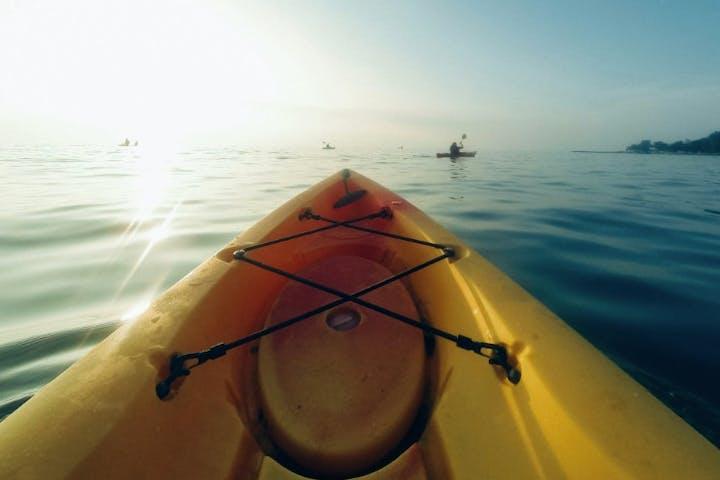 yellow kayak into the sea
