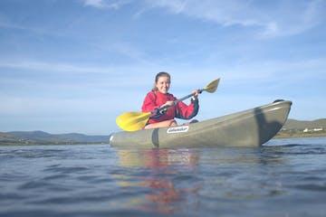 woman paddling happy on a kayak