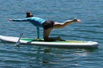 Stretching on a paddle board