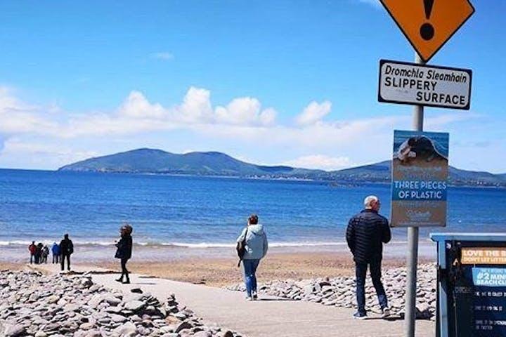 people walking near the coast in Ireland