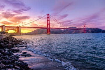 The Golden Gate Bridge during a sunset.
