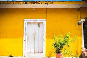door surrounded by a yellow wall
