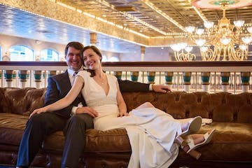People on the Grand Chandelier Deck of the Southern Belle Riverboat