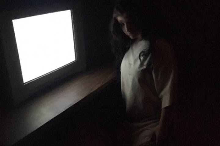 dead girl in front of a static tv